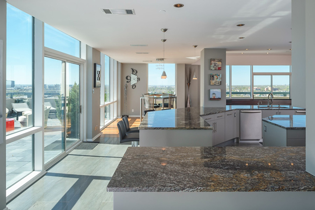 The kitchen connects the home while getting center stage views of the terrace
