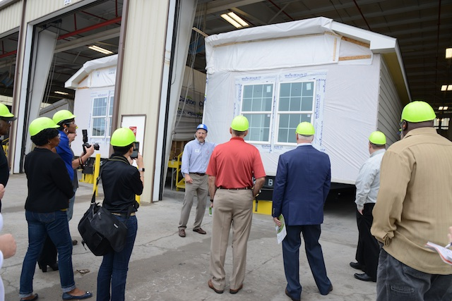 The first duplex built by Clayton Homes Waco II for NeighborWorks in Waco comes off the assembly line (photo: Lisa Stewart Photography)