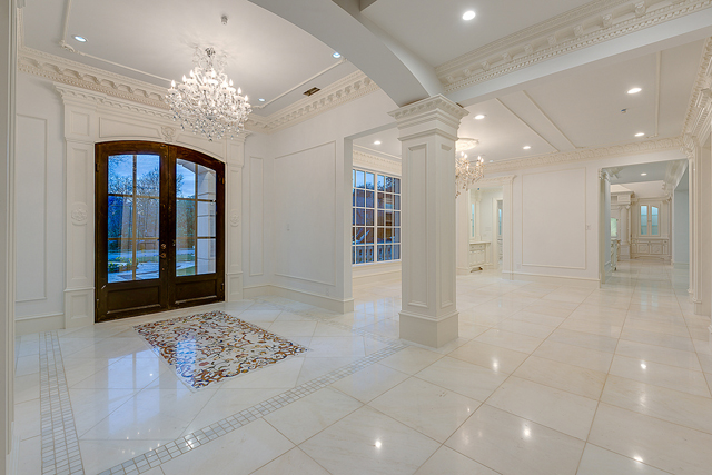 "Grand entry with large format marble tile surrounding mosaic ""carpet"""