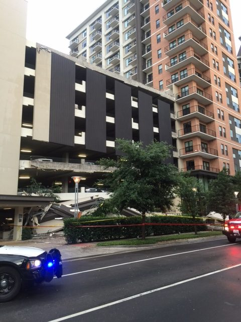 The parking garage at the Taylor Luxury Apartments in Uptown suffered a partial collapse at the front of the building Monday evening. (Photo by Candy Evans)