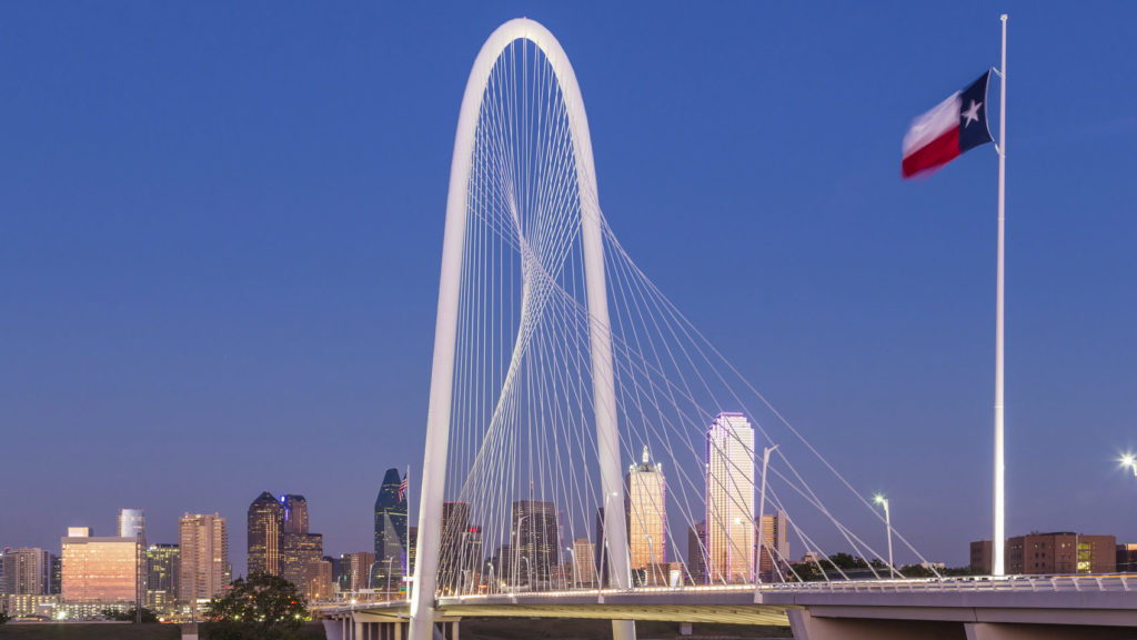 Dallas downtown skyline with Margaret hut hills bridge at night.
