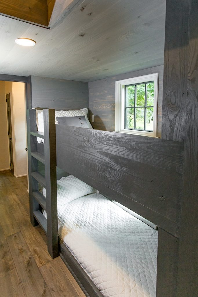 The Low Country model can sleep up to 8 comfortably and has built-in bunkbeds and a separate bedroom.