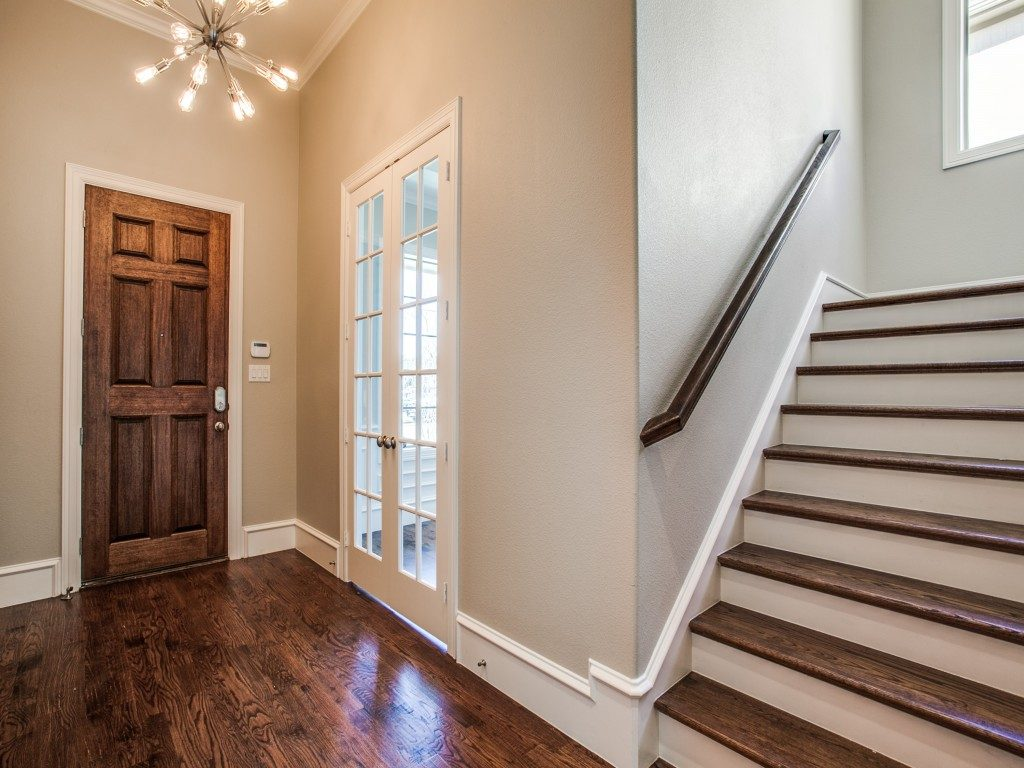 dallas wood home office wood paneling inside the entryway gives you first hint of stylish decor with retroglam chandelier rich hardwoods and home office wainscoting gorgeous home on santa fe trail is in dallas next hot neighborhood