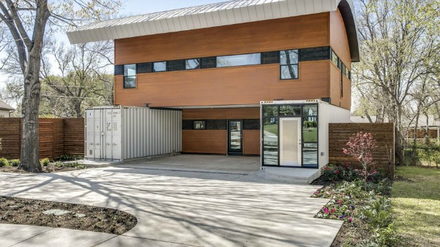 This three bedroom, three-and-a-half bath modern in Midway Hollow by builder Marc features two shipping containers.