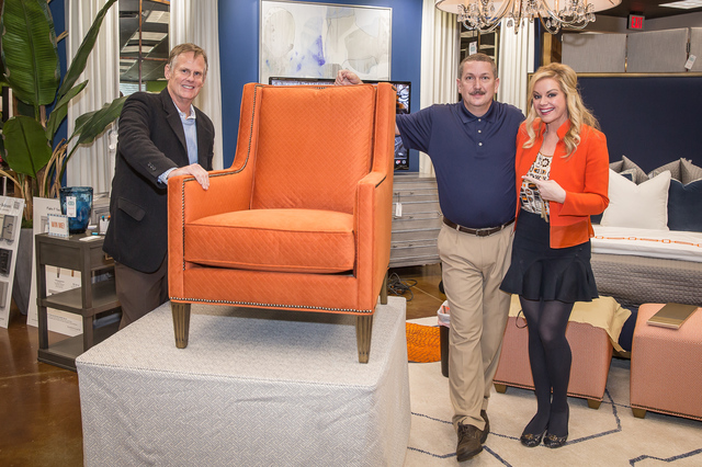 Shay Geyer poses with representatives from Vanguard Furniture with the chair the company built at the IBB Day of Design on Feb. 25.