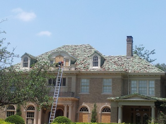 A freak hail storm a few years ago completely wrecked the tile roofs of the historic Swiss Avenue neighborhood. (Photo: Amy Curry)