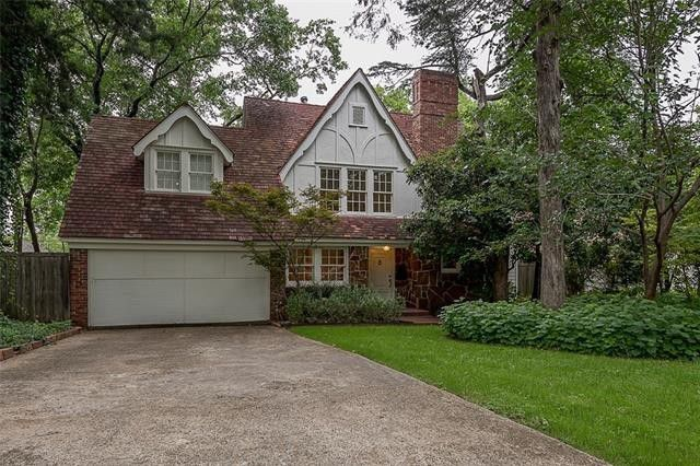 Splurge vs. Steal: Two Catercorner Kessler Park Tudors Built in the 1930s | CandysDirt.com