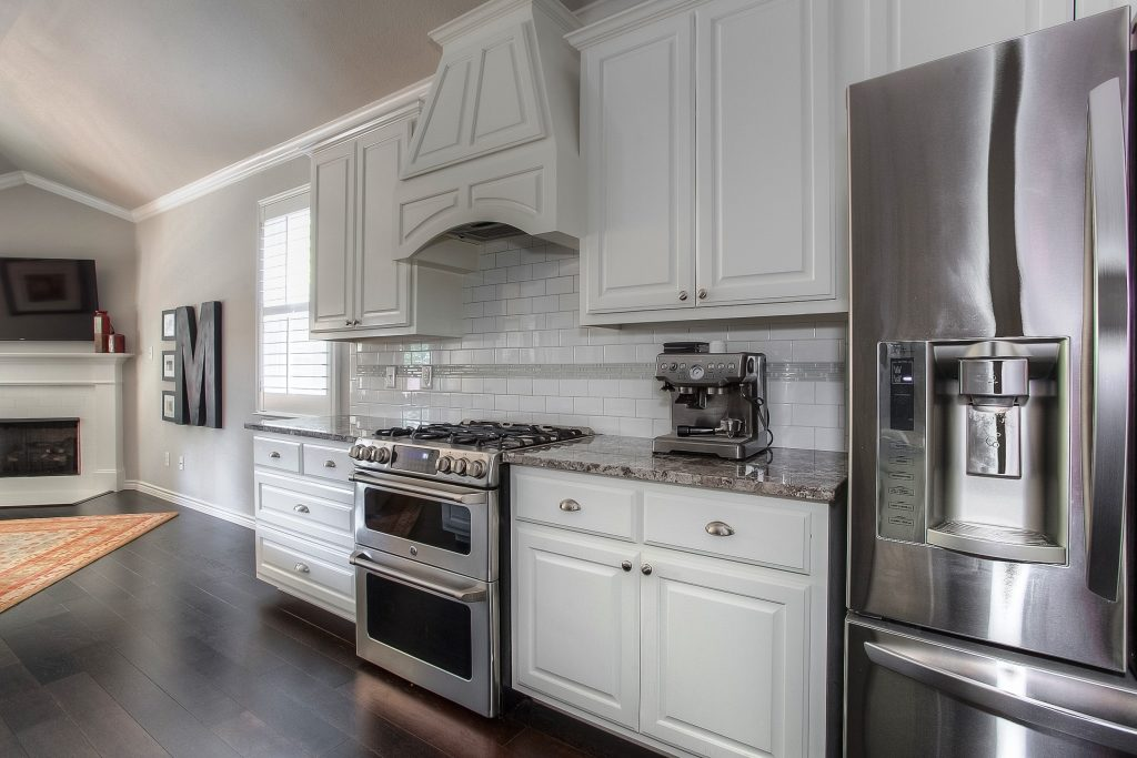 Painted cabinets, double oven gas range at 5128 Collinwood Ave.