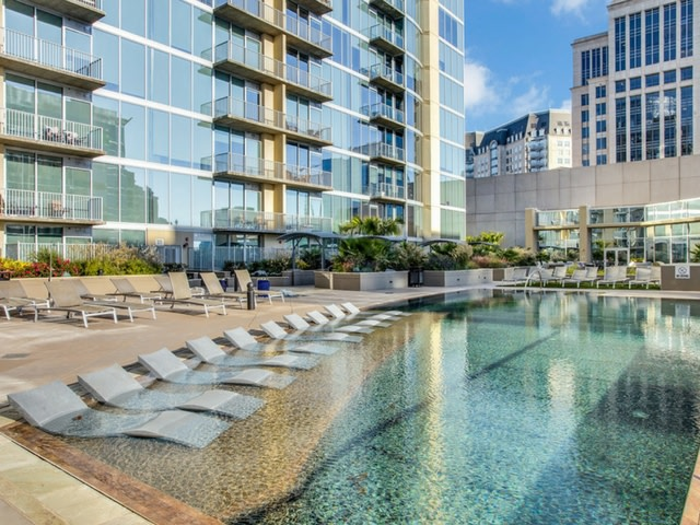 The most luxurious dallas area apartment pools for Live oak rooming house dallas tx