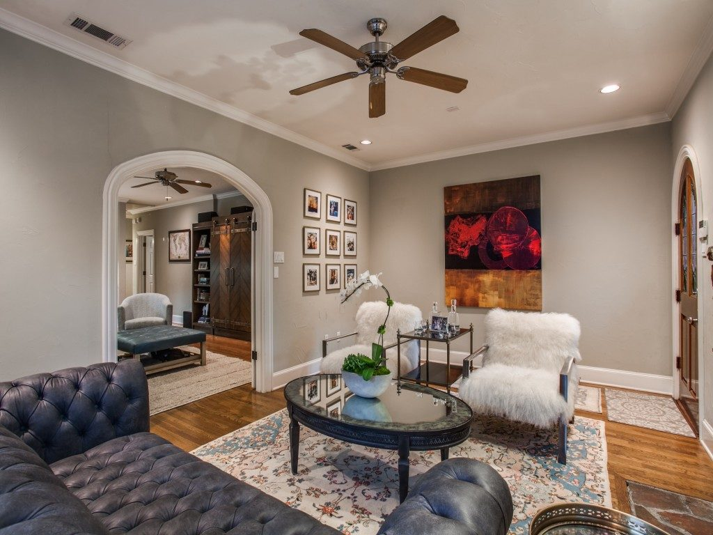 french formal living room. Elegant Arched French Doors Separate The Family Room From Formal Living Which Features An Original Stone Fireplace With Brothers Homes. Y