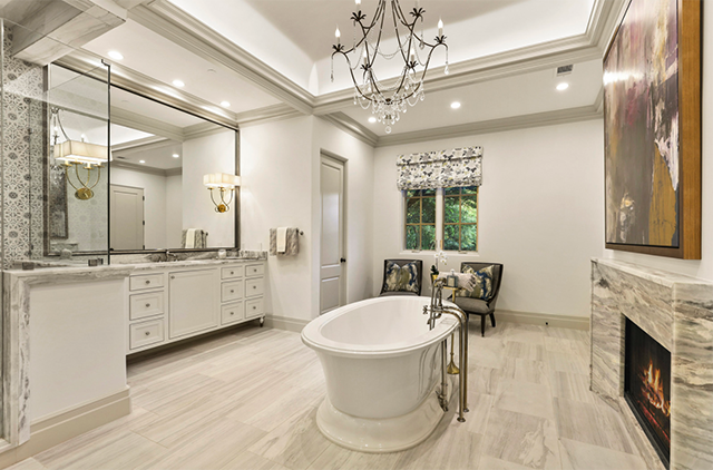 The ultra-luxe master bath and closet sport every amenity.