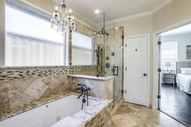 The master bath includes a jetted tub and a separate shower.