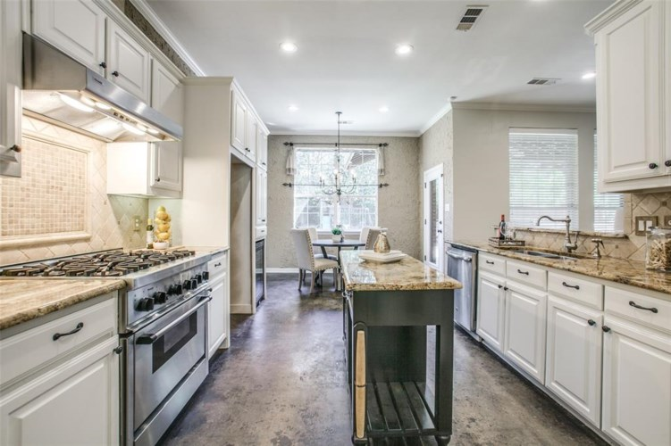 The kitchen includes a Thermador 8-burner, dual-fuel commercial range.