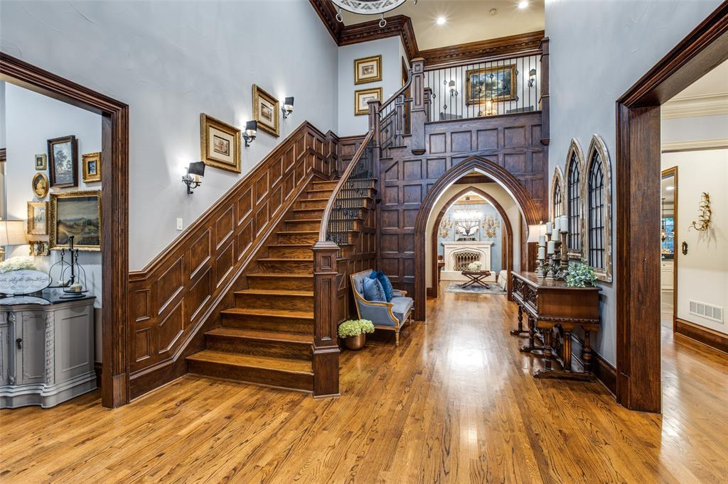 The entryway at 5705 Morlaix Court at this traditional home in Colleyville is majestic with its crafted wood features.