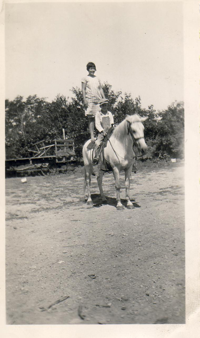 Ebby standing on horse